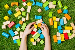 Creativly constructing from color wooden blocks - stock photo