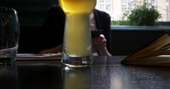 Beer glass and addicted to mobile phone woman Stock Footage