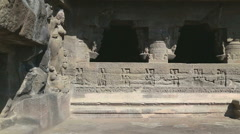 Stock Video Footage of View on the outdoor walls and entrance to rooms of Aurangabad caves.