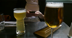 Stock Video Footage of Beer glasses and addicted to mobile phone woman