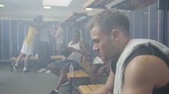 4K man in gym locker room rehydrating with water after a workout Stock Footage