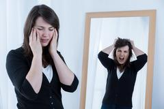 Woman trying to mask emotions Stock Photos