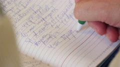 Man takes notes at a conference 2 Stock Footage