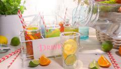 Making fruity lemonade in the summer kitchen - stock footage