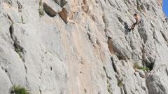 Caucasian person rock climbing Stock Footage
