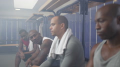 4K Disappointed sports players in team locker room, reflecting on a losing game. Stock Footage