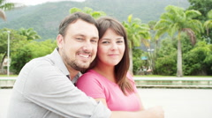 Brazilian couple smile at a park in Brazil - stock footage