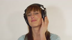 SLOW MOTION: Woman in love listening to romantic music Stock Footage
