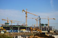 Builder worker with Machinery Building Construction Site Stock Photos