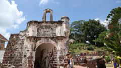 Tourists visit ruins of the Portuguese A Famosa fortress Stock Footage