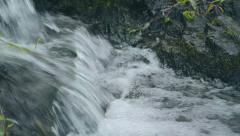 Clear potable flowing water from waterfall stream Stock Footage