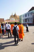 monks and other young visitors explore  National Palace - stock photo