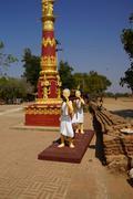 Monks carrying large gong Kuvituskuvat