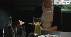 Woman choosing food from menu at restaurant Arkistovideo
