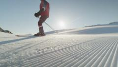 SLOW MOTION: Skiing on perfectly groomed snow in sunny morning - stock footage