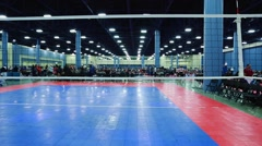 Point of view of person approaching Volleyball net at indoor court Stock Footage