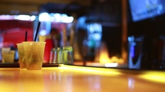 Cool shot of Two Drinks on top of a Bar - stock footage