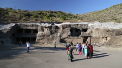 Tourists in front of entrances to Aurangabad caves. Stock Footage