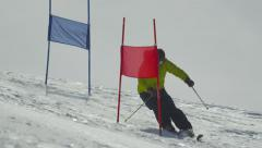 SLOW MOTION: Slalom skier skiing between the gates - stock footage
