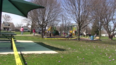 Childern swinging in a park - stock footage