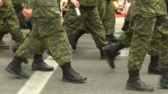 Close up of soldiers passing by the camera Stock Footage