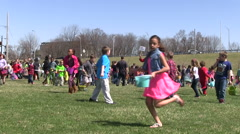 Children Running in an egg hunt Stock Footage