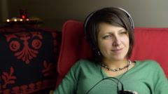 Green eyed, young woman is swaying, listening music with headphones, dreamy mood Stock Footage