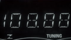 A white number as tuner on a radio Stock Footage