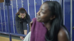 4K Cheerful attractive young women chatting in ladies' locker room at the gym Stock Footage