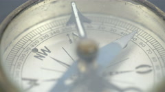 An old small round compass on a table Stock Footage