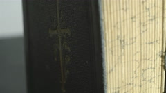 A cross image in front of the bible Stock Footage
