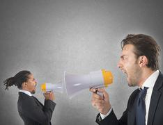 Employee yelling against boss - stock photo