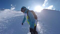 SELFIE: Snowboarder riding powder snow in mountain ski resort - stock footage
