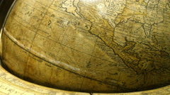 A big brown globe showing the map of North America - stock footage