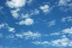 expanse of clouds in blue sky - stock photo