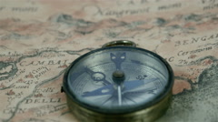 A round compass with its pointer moving Stock Footage
