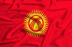 Kyrgyzstan flag on a silk drape waving - stock illustration