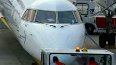 Two workers on a airport jeep infront of an airplane Stock Footage