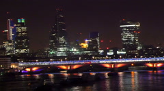 Tall skycrapers and establishments in London at night - stock footage