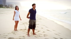 Man gives woman piggyback ride on a beach in Brazil Stock Footage