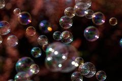 The rainbow bubbles from the bubble blower Stock Photos