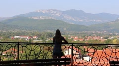 Girl Looking Far Away from the Balcony 1 - stock footage