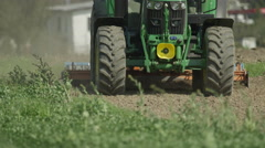 SLOW MOTION CLOSE UP: Farmer working on field with tractor Stock Footage