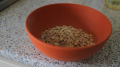 Oat flakes in a bowl pour water and stir with a spoon Stock Footage