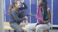 4K Cheerful attractive young women chatting in ladies' locker room at the gym - stock footage