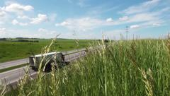 Meadow. Cars on the road Stock Footage
