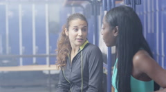 4K Portrait of cheerful young women chatting in locker room at the gym Stock Footage