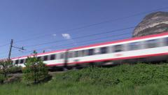 Austrian ÖBB Train Munich-Bologna running through the valley in South Tyrol Stock Footage