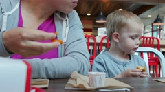 Mother and son at fast food restaurant Stock Footage