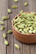 Green cardamom ayurveda asian aroma spice in a wooden bowl on vi - stock photo